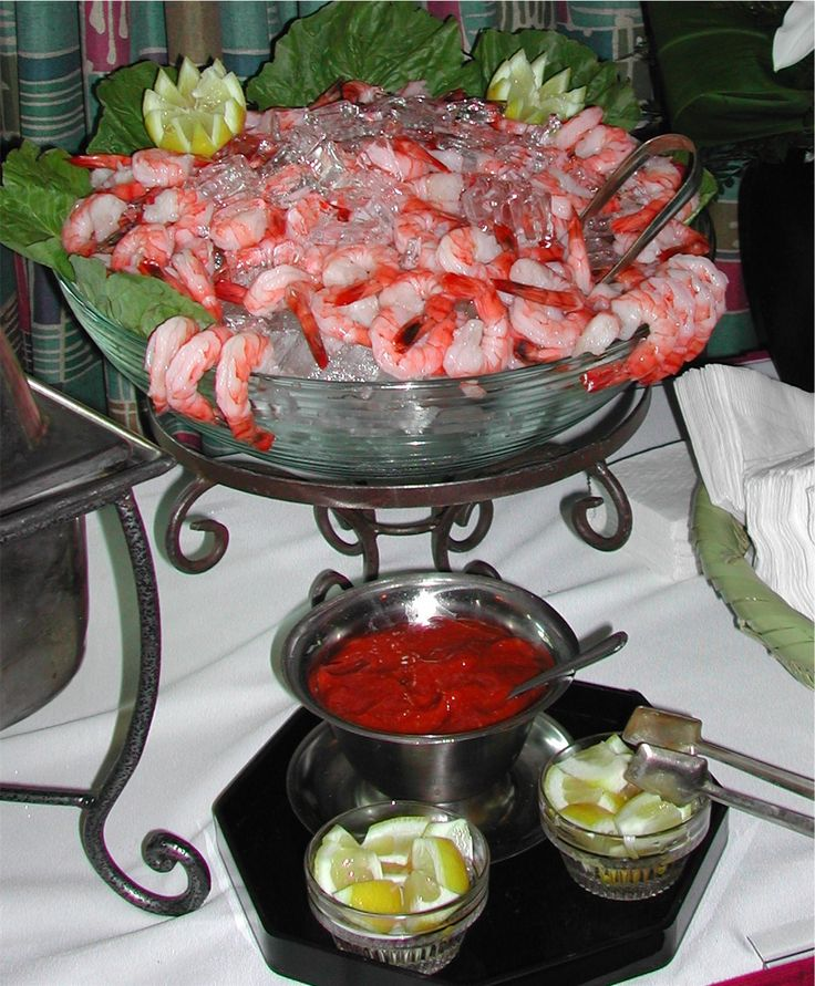 .shrimp cocktail inpiration display. 2 orders of ready made shrimp - Costco. Need crushed ice.