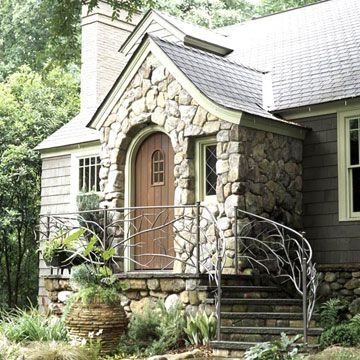 Cottage Style home!  I think this one characterizes my dream house because it is cozy with not too much extra space, arched doors, and natural siding! Throw in big windows and it's mine!