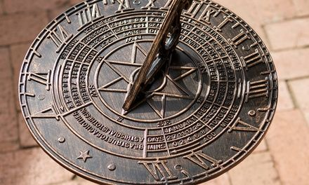 Brushed antique gold sundial adds regal, eclectic style to landscaping as a decorative yet functional piece