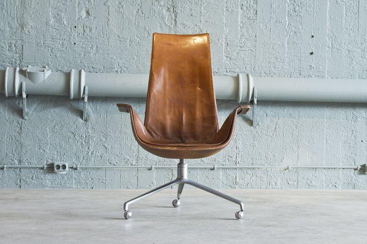 "Chromed swivelling steel base, brown leather armchair fk 6725 ""Tulip"" for Kill International. High back desk chair, vintage leather.."