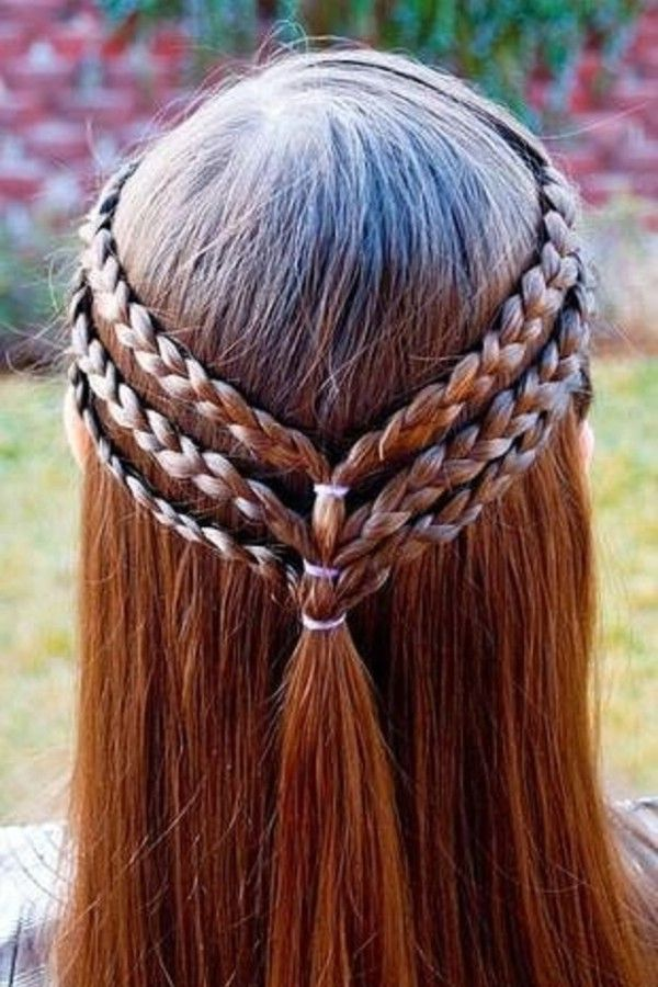 side part, half-up, three small basic braids on each side drawn back.