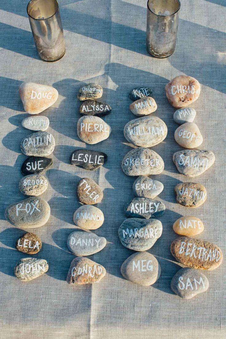 Rocks are the perfect, beachy place card for outdoor weddings. They are heavy so they don't blow away and can even be used to anchor lighter items at the table. You can just use a Sharpie to write on them, no paint required! You can find attractive, bulk rocks at some home improvement stores and at rock suppliers if you have those locally.
