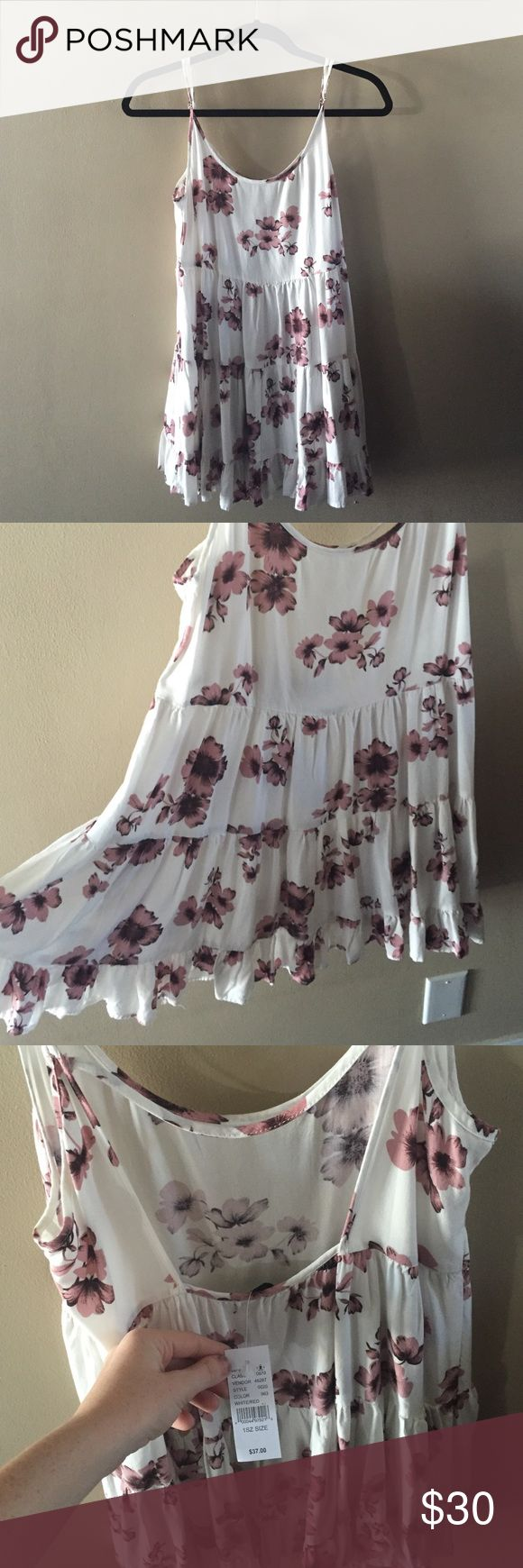 Pink and white floral skater dress It's a spaghetti strap dress that I've never worn. Bought it cause it's cute but I don't like the straps. One of brandys signature dress designs. Brandy Melville Dresses Mini