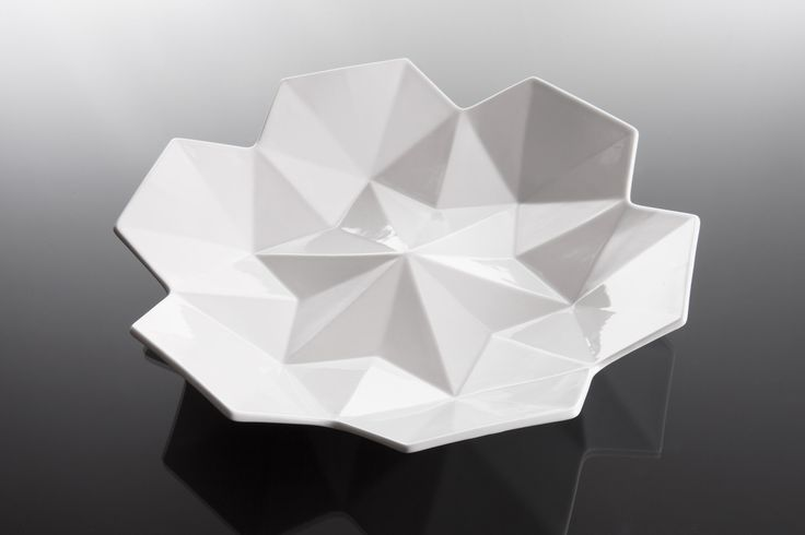 £80 Large Serving Bowl Lilia large serving bowl fuses the geometry of Czech Cubism with the beautiful contours of the water lily. Crafted from the highest quality Czech porcelain, it displays the pinnacles of craftsmanship in Europe. Owing to its striking, contemporary appearance, it is the perfect addition to any modern home or office.