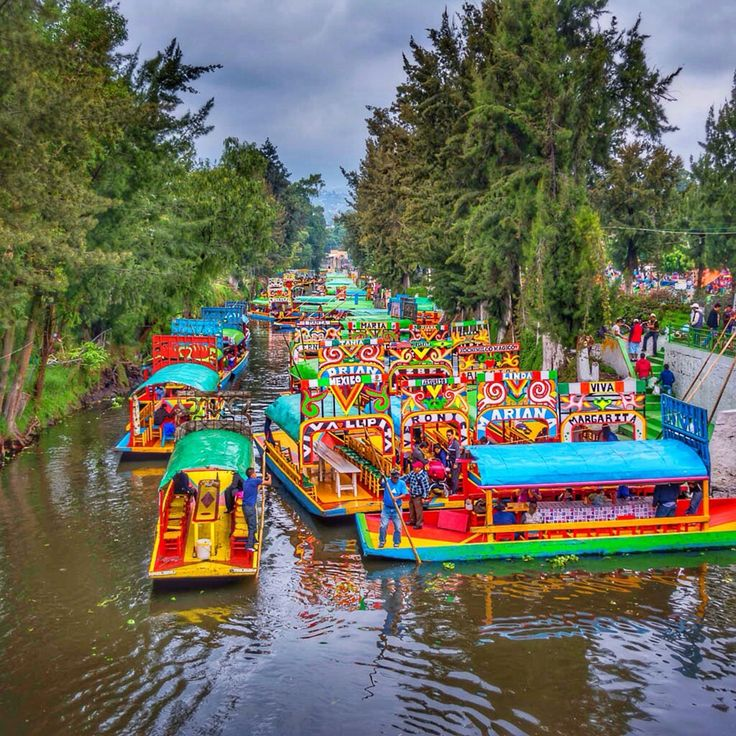 Embarcadero Nativitas, Xochimilco, Mexico City, Mexico - A World Heritage Site, Xochimilco is known for its canals that date back from the pre-Hispanic era. A ride in a colorful trajinera is a must if you are in Mexico City and want to get a taste of its rich culture. Some of the trajineras have mariachis, others delicious food, and some sell flower crowns. A unique experience we recommend!
