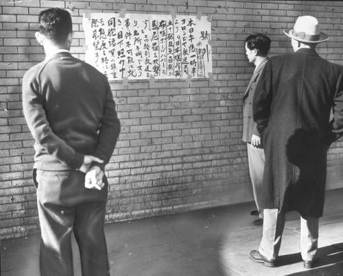"""Page 1 :: """"Japanese in Little Tokyo are shown watching bulletins as the war started"""" -- caption on photograph :: Japanese American Relocation Digital Archive, 1941-1946. http://digitallibrary.usc.edu/cdm/ref/collection/p15799coll75/id/1530"""