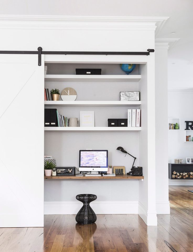 hidden office nook behind a sliding barn door need to work in your living room but hate to show your work clutter a sliding barn door is both stylish bury style office desk desks