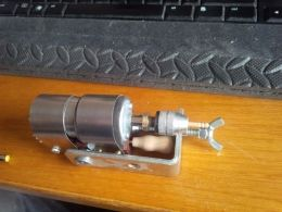 Micro Wood Lathe - Homemade micro lathe driven by a 24v printer motor. Draws power from a laptop power supply.