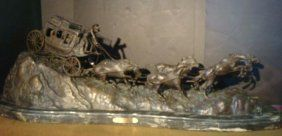"""Lot #610 (26th May, 14) - Live Auctioneers Bronze Sculpture STAGE COACH After CHARLES RUSSELL: American Listed Artist, 1864-1926. 13"""" X 40"""" X 12"""" Mounted on 2"""" X 49"""" X 16"""" Green Marble Base. Lost Wax Casting of 6 Horses Pulling Stage Coach on Rocky Platform. All Reins in Tact. Brass Plate Bearing Name. Hand Finished. One of Artist's Most Famous Pieces. Weight is 200 Plus Pounds. (1000-2000)"""
