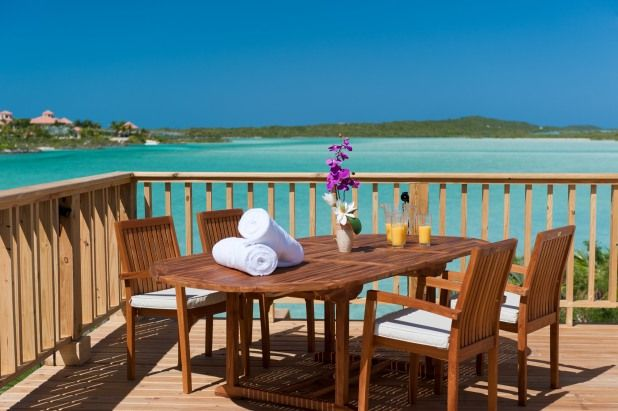 Enjoy the water view from this beautiful deck in Turks and Caicos. #vacationhomerentals