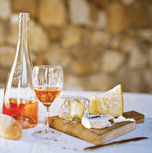 Enjoy a glass of wine and French cheese in Provence.