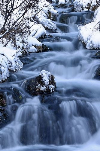waterfall with snow- amazing landscape - nature photography