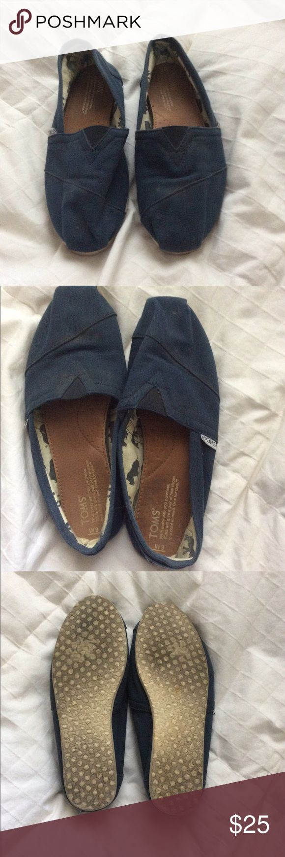 Navy Blue Toms Gently used tons worn at most 3 times! The sole on the inside is like new, just a little dusty on the outside since I never wear them, they were my first toms and were just slightly too big! Any questions feel free to ask! TOMS Shoes Flats & Loafers