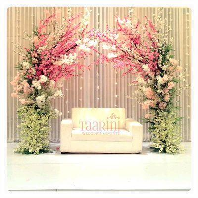 pink,green and white flower arrangement  decor, white sofa,white ladi back drop, pretty decor, subtle decor , simple decor