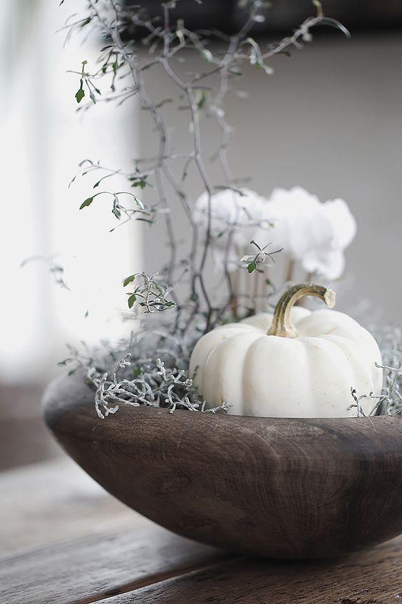 pretty white pumpkin vignette in wood bowl