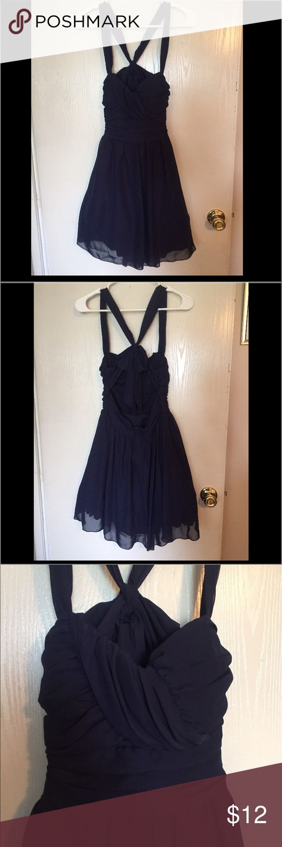 Beautiful semi formal dress! Navy blue with bow! This deep navy blue silky dress has a mini crinoline !! Kris cross back with a bow that stays tied!! Zips up the back lined and gathered in front so you don't have to wear a bra!! This dress has no size tag but I assure you it's a small! Dresses Mini