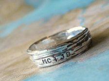 such a cute idea like for a promise ring or simple engagement ring--  personalized with initials on the appearance of tree bark.