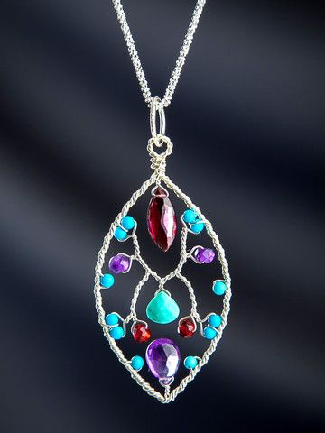 Sarasvati is the Goddess of all arts, and we think this is something she might wear. Four of our richest gemstones are woven together into a garden scene of disarming beauty. Turquoise, Amethyst, Garnet and Sleeping Beauty Turquoise work together in ways other colors just don't.