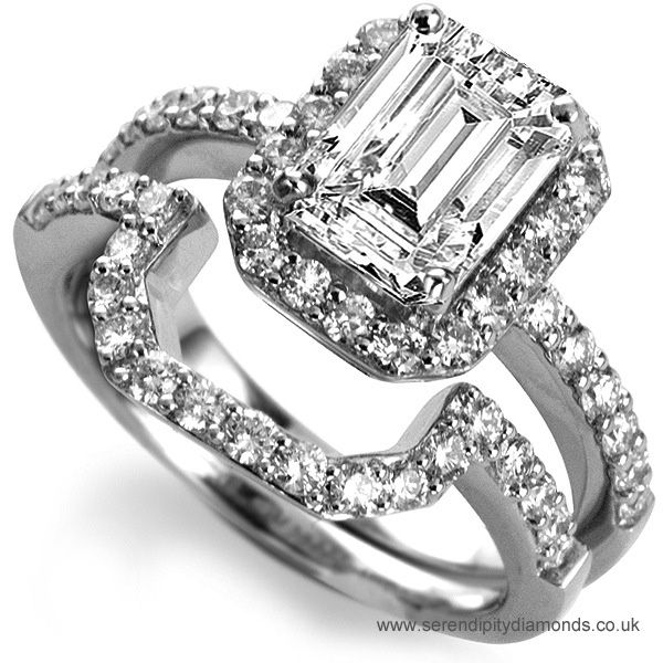 Emerald cut diamond halo ring. An elegant diamond halo ring with diamond set shoulders. Shown here with matching wedding ring available to order separately.