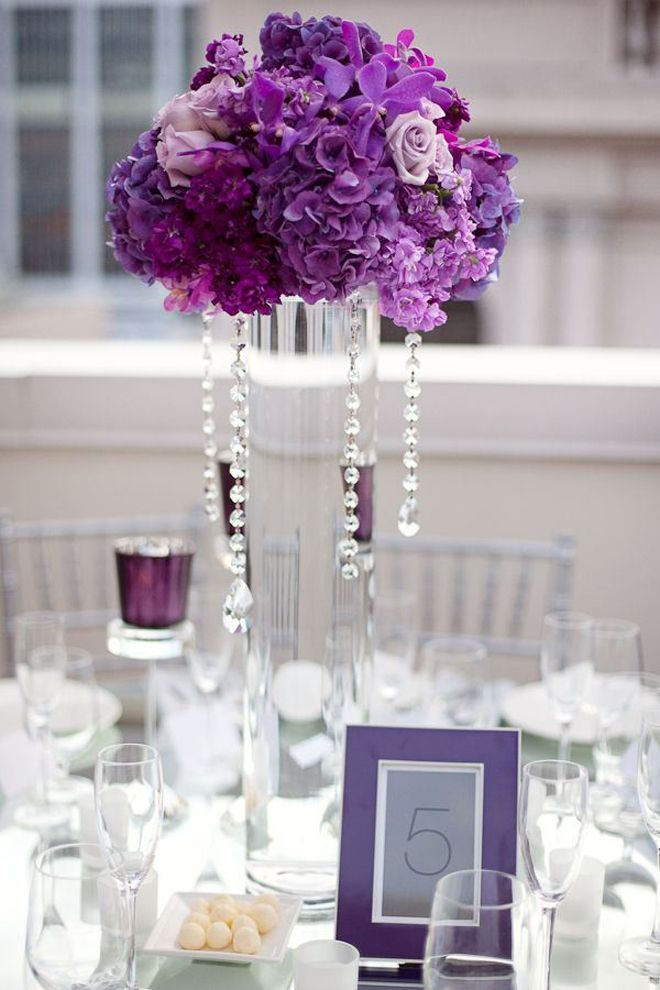 Purple tall wedding centerpiece with hanging crystals
