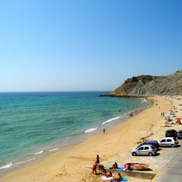The Western Algarve, Portugal - 11 under-the-radar trips in Portugal you shouldn't miss - via AFAR Magazine | Photo: Beach, Burgau, Portugal