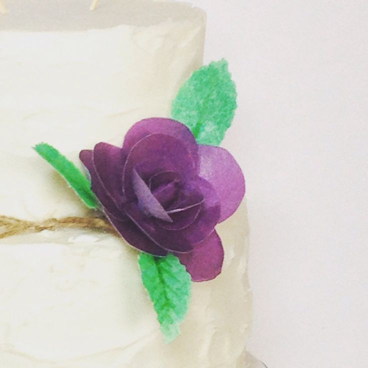 Classic buttercream with wafer flower.
