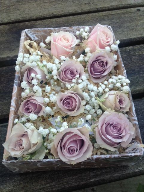 Lilac rose and gypsophila button holes