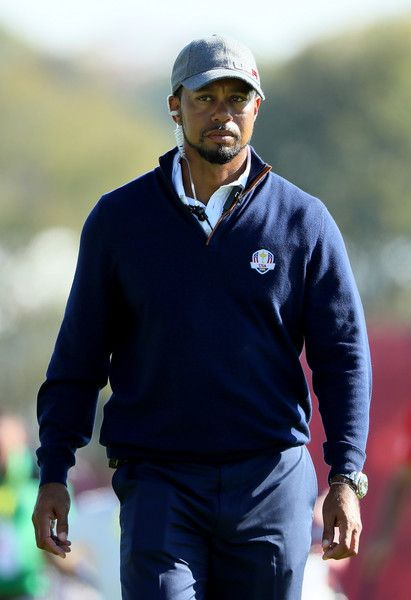 Vice-captain Tiger Woods of the United States looks on from the ninth hole during afternoon fourball matches of the 2016 Ryder Cup at Hazeltine National Golf Club on September 30, 2016 in Chaska, Minnesota.