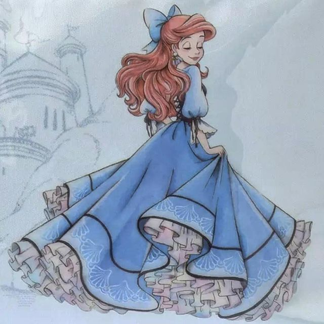 Ariel In Her Beautiful Blue Dress With A Blue Bow In Her Hair