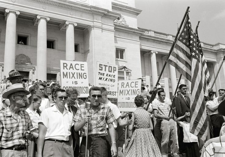 """People on the wrong side of history.  1959: People holding signs and American flags protesting the admission of the """"Little Rock Nine"""" to Central High School in Arkansas."""