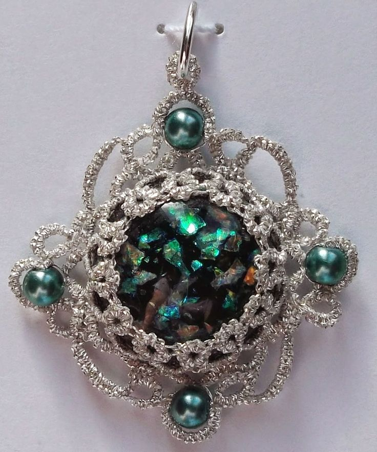 """Scroll Work      Finally back to normal and Tatsmithing again.  This one was tatted with two strands of Coats and Clark, silver sewing thread.  The pendent measures 1.5"""" in diameter"""
