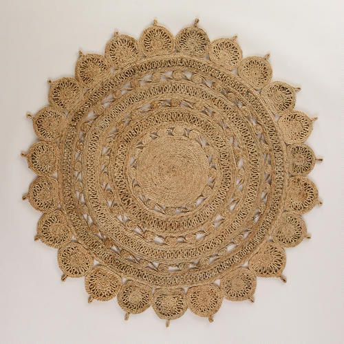 Could be really cute in club chair space!  One of my discoveries at WorldMarket.com: 5' Round Handwoven Jute Rug