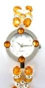 Reloj de pulsera con esfera y abalorios paso a paso.
