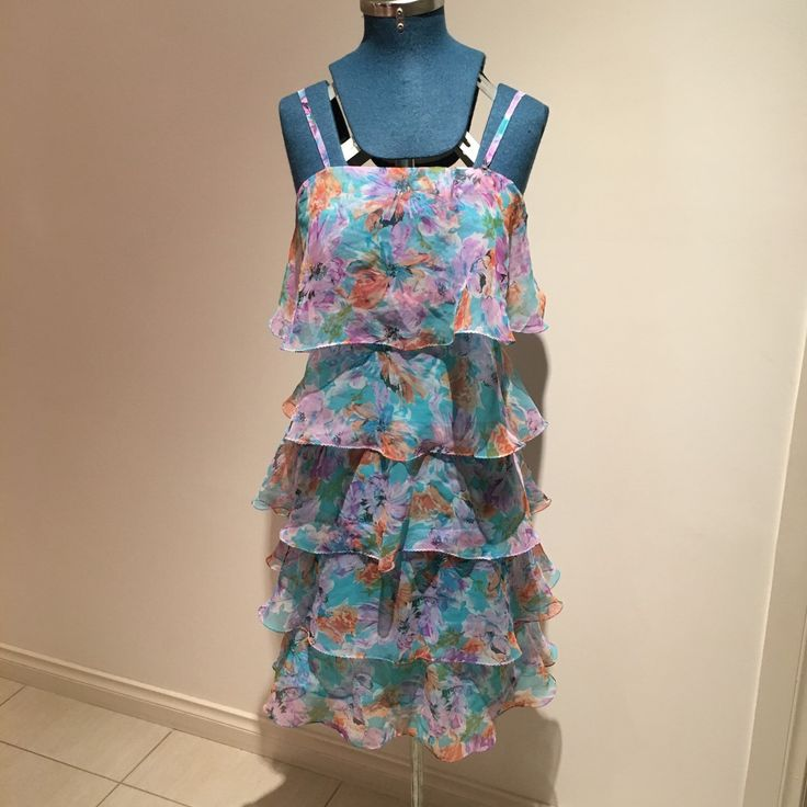 A personal favourite from my Etsy shop https://www.etsy.com/au/listing/285390277/vintage-1990s-layered-ruffle-dress-in