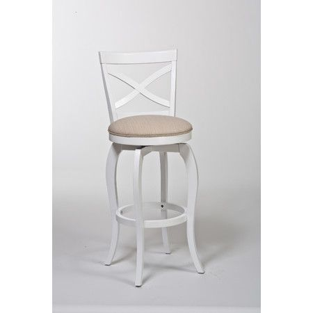 Counter stool with an X-back and upholstered swivel seat.    Product: Counter stoolConstruction Material: Hardw...