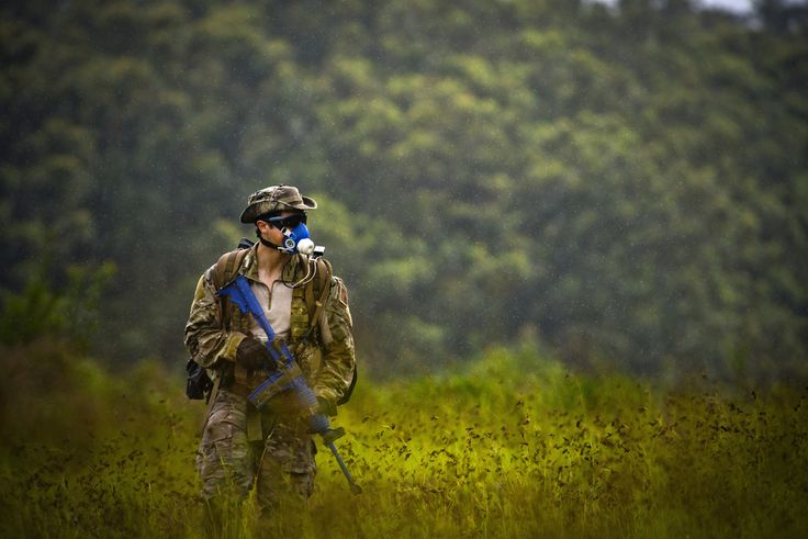 A combat controller, wears a mask designed to measure his maximal oxygen uptake during a jungle warfare training exercise