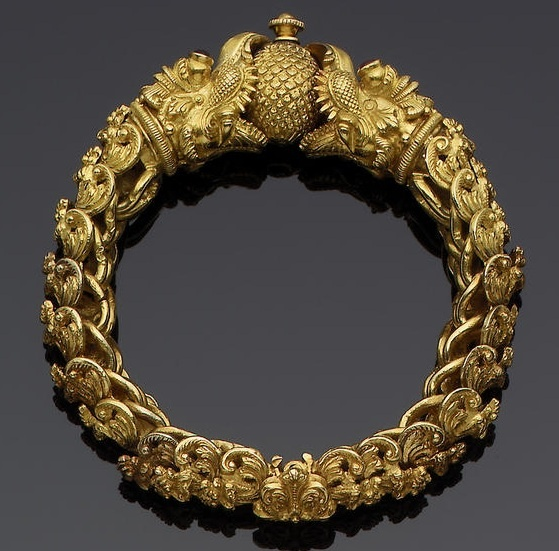 India ~ Tamil Nadi | Gemset gold bracelet; interlinking elements in the form of floral kirttimukhas, the termimals in the form of makara heads, holding an orb between their open mouths, the eyes gem-set  | ca. 1st half of the 20th century