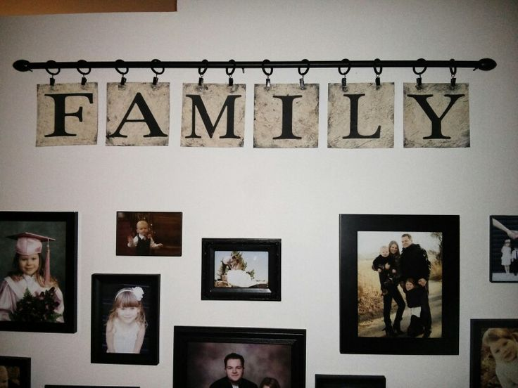 My DIY Family Sign. Curtain rod, curtain clips, cheap linoleum from the dollar store, black craft paint. Cut lino into 6x6 squares. Apply paint and wipe off for rustic look. Print and cut out letters. Glue on with mod podge.