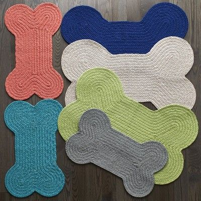 Our bone-shaped dog bowl rug is a fun way to define your dog's dining space. Perfectly sized rug for your dog's food and water bowls.