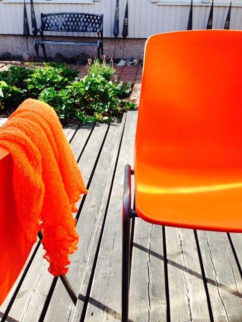 Garden design by Helena Kemppainen. Orange sparks dark hues.