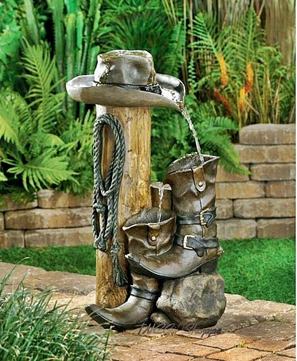 Western Garden Ideas western red cedar hedge google search Cowboy Equipment As A Garden Fountain Garden Fountains See More Creative Ideas At