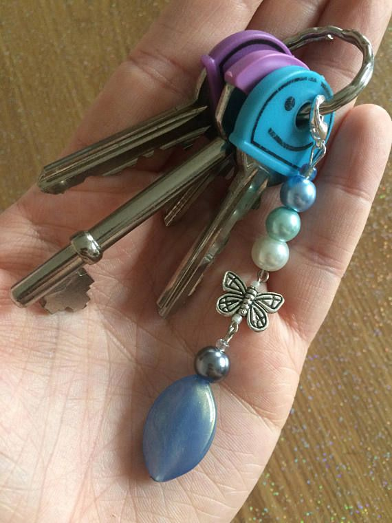 This unique keyring charm has been crafted to add a touch of colour and beauty to your keys or bag.  - Approximately 9cm long - Attaches by a 10mm lobster clasp  It is also perfect to give as a beautiful gift to your best friend, a partner or a family member. Would do well for birthdays, celebrations and as a stocking filler.