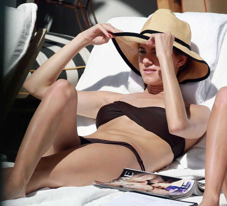 Pin for Later: Over 50 Celeb Snaps to Inspire Your Best Bikini Style Allison Williams Allison Williams lounged in a brown bikini with a straw hat during a trip to Miami in February 2013.