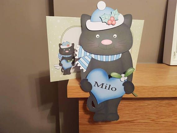 Check out this item in my Etsy shop https://www.etsy.com/uk/listing/556002398/black-cat-card-in-blue-holding-a-heart