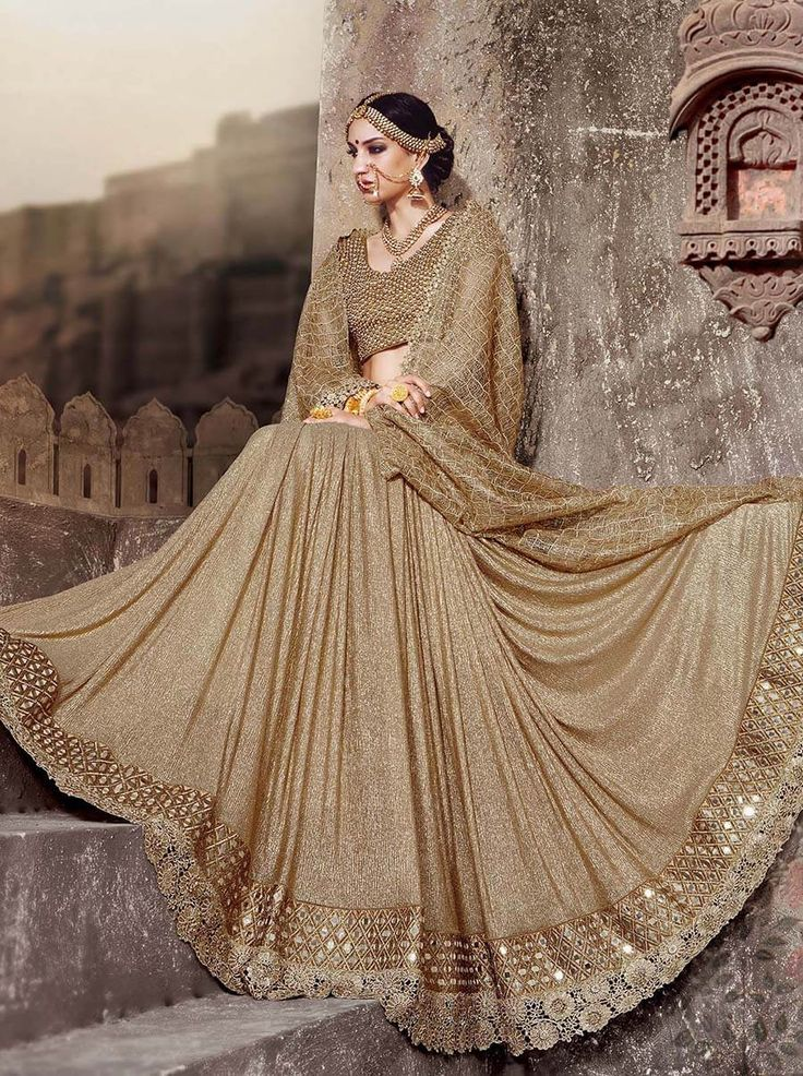 Subtle yet elegant golden saree with embroidery and all over moti work Gota Blouse especially for wedding, reception and festivals.  Facebook: https://www.facebook.com/drezzling