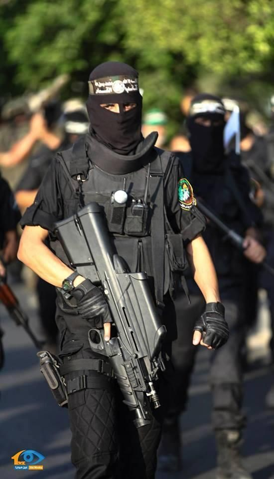 Member of Al Qassam holds his rifle during a military parade in Gaza.
