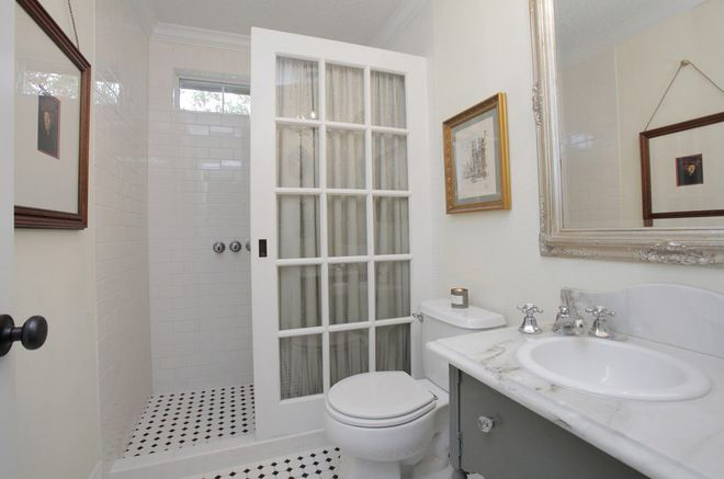 bj> alternative to expensive glass water partition for shower/tub; eclectic bathroom by Lindsay von Hagel