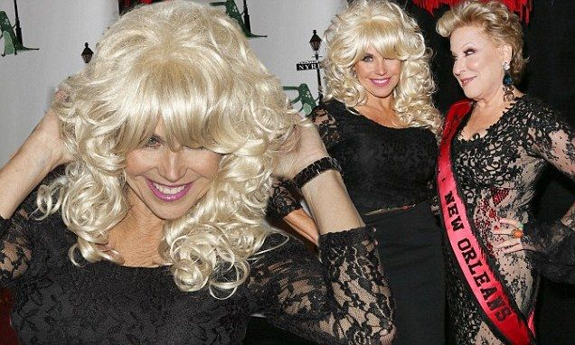 Katie Couric pads her bra and dons a wig for Dolly Parton costume