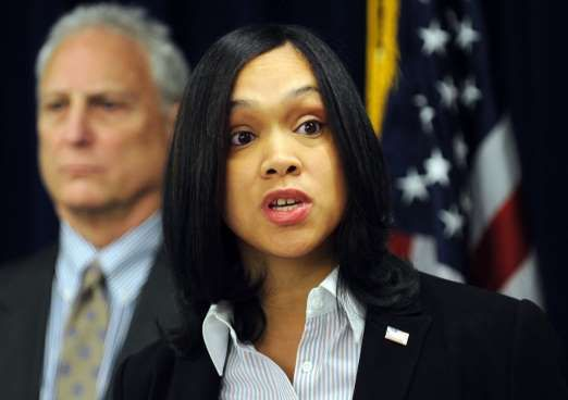 3, 2015 photo, Marilyn Mosby, right, Baltimore City State's Attorney, holds a press conference regarding the Phylicia Barnes case. At left is Deputy Chief Michael Schatzow. Baltimore's chief prosecutor is 35 years old, has been on the job for less than four months, and is about to take on the biggest challenge of her career weighing the evidence against six police officers in the death of Freddie Gray and deciding whether they deserve to be criminally charged. (Algerina Perna/The Baltimore…