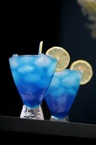 Blue punch recipe. 45 ml raspberry vodka, 30 ml blue curaçao, 15 ml fresh lemon juice, sprite. Build over ice in lg goblet garnish w/ blue cherry